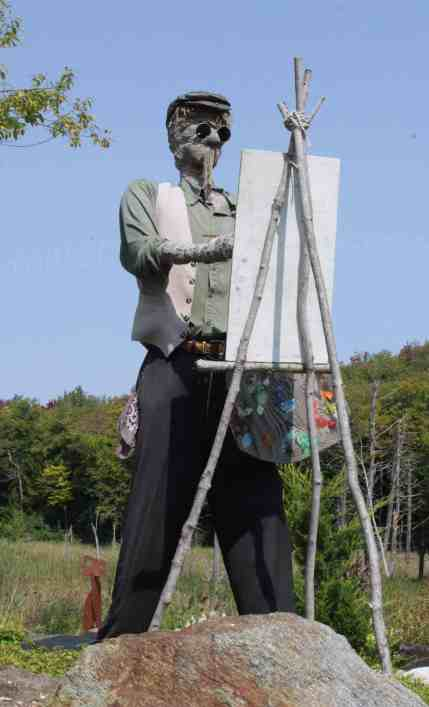An artist paints en plein air (hint) near Don Quixote. Photo by Thom Smith