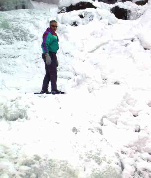Scott Jervas of West Stockbridge snowshoeing across Wahconah Falls following an extended period of below zero weather several years ago. Photo by Thom Smith