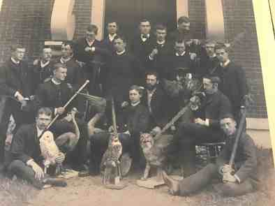 Students in the Lyceum at William college in the 19th century pose with artifacts from their collection. Image in The Field Is the World at the Williams College Museum of Art.