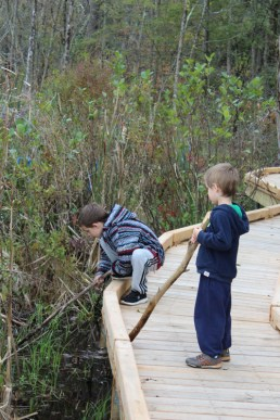Patrick and Gabriel Smith O'Connor explore the marsh on and off the boardwalk. Photo by Thom Smith, courtesy of the artist