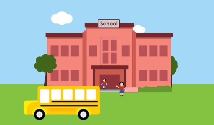 schoolgebouw met schoolbus