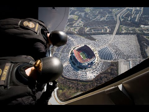 NAVY SEALS's insane parachute jump into football stadium caught on cam