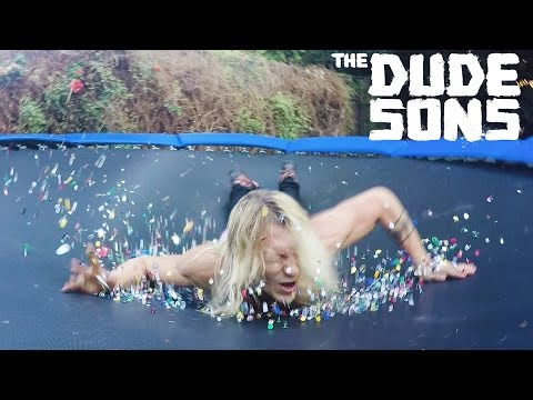Guy belly flops onto a trampoline full of thumbtacks! Ouch!