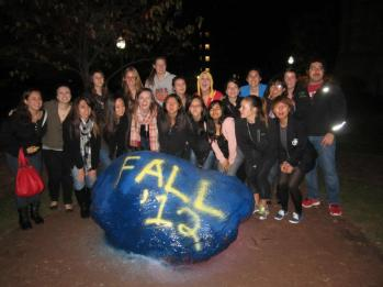 Members of the fall 2012 pledge class gather around the rock.