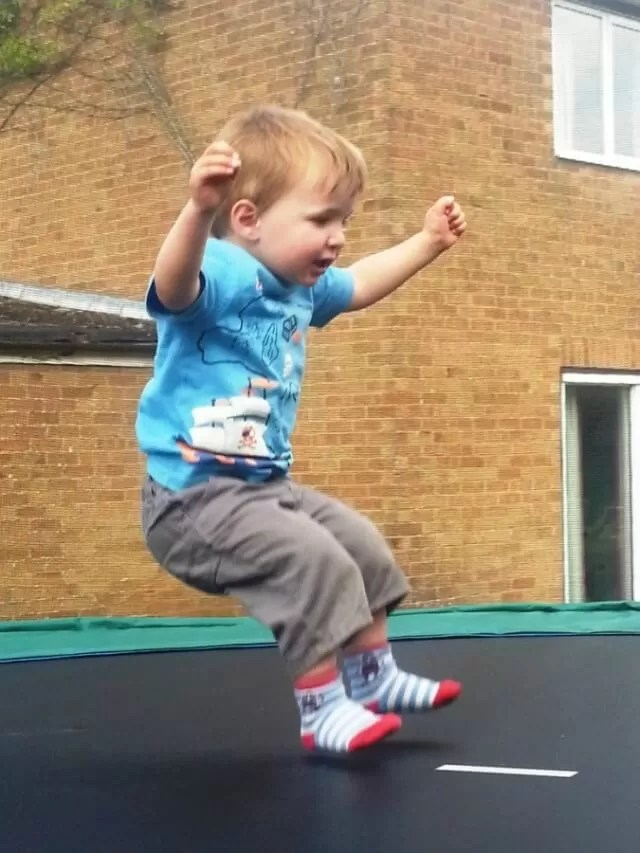 bouncing down on trampoline
