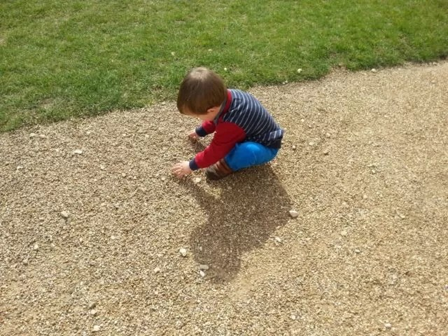 child playing with gravel