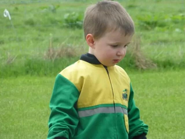 boy in john deere overalls