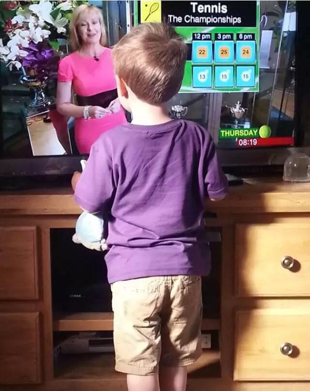 purple t shirt watching tv