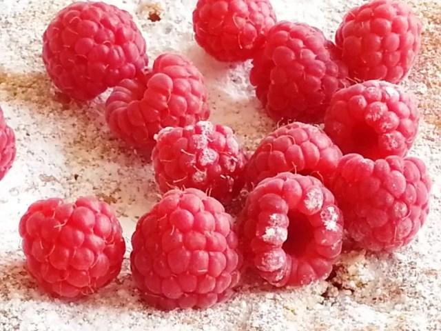 raspberries atop a cake
