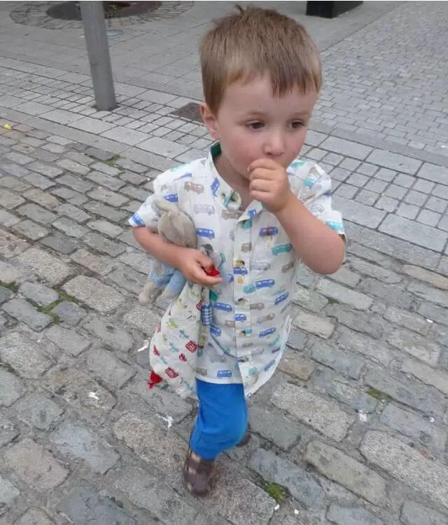 campervan-shirt-and-chinos toddler sucking thumb