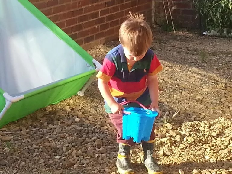 carrying the water bucket