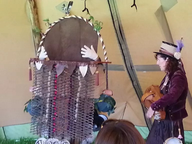 children's hand and mouth puppet show at treefest