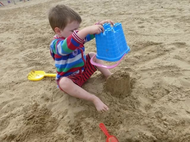 revealing the sandcastle