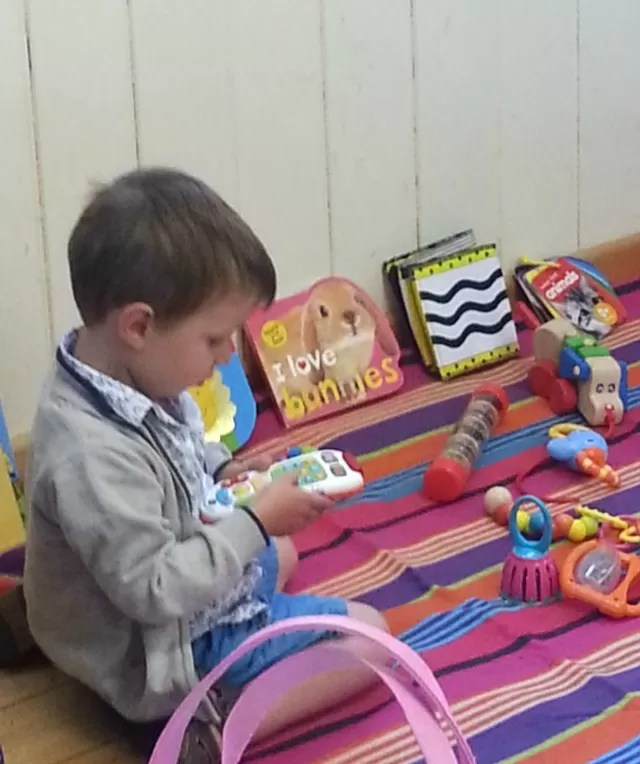 enjoying playing with baby toys