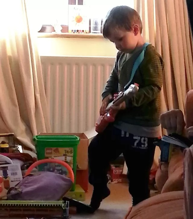 rocking with a toy guitar