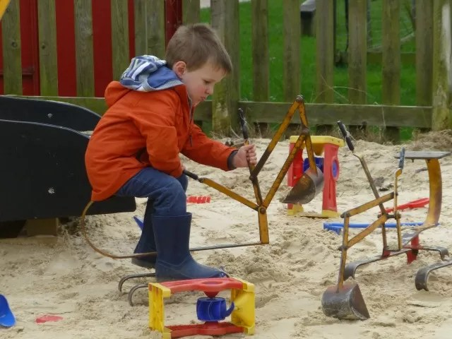 playing on the sandpit cranes