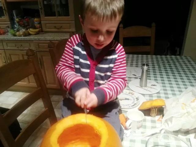 hacking at a pumpkin