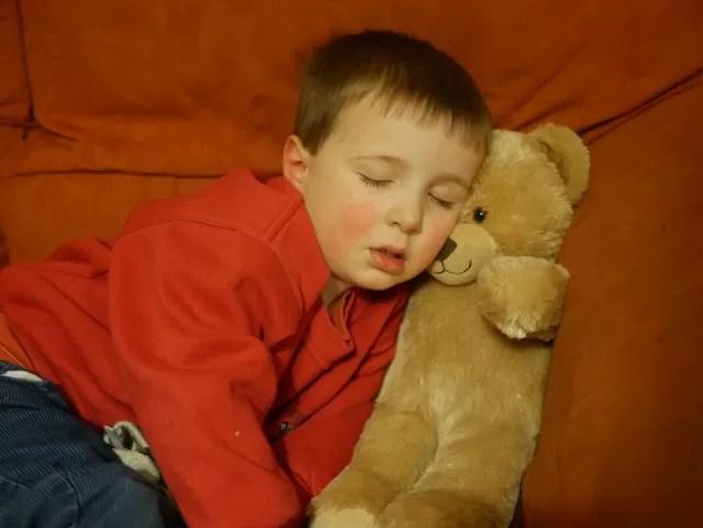 a boy and his teddy bear...asleep