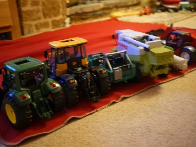 parked up Bruder and and Britains tractor toys
