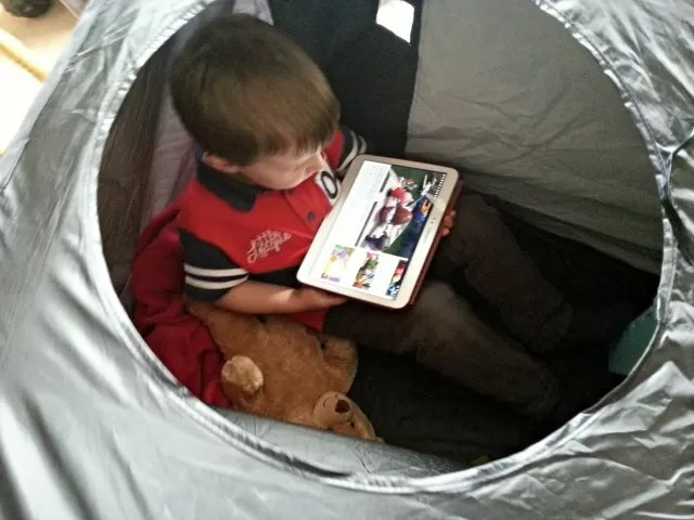 Setting up camp in his Glow Crazy tent