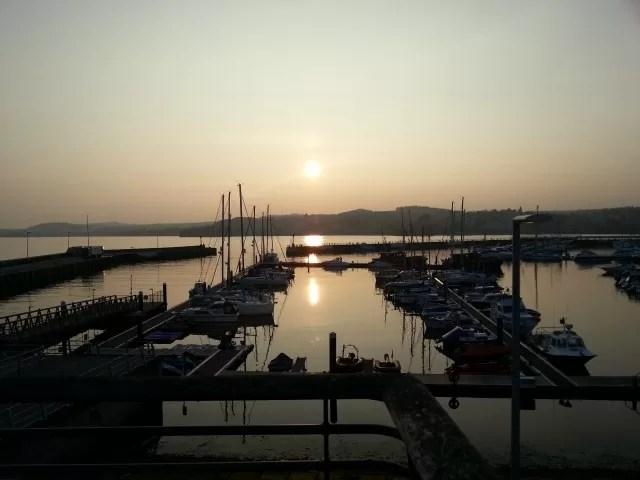 sunset over torquay harbour