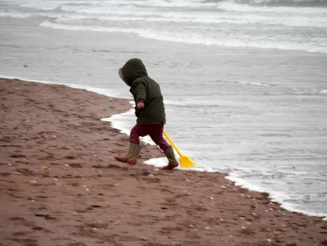 running from the sea at Paignton