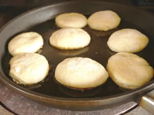 donuts frying in oil on the aga