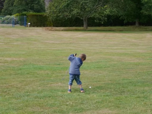 playing golf at Lulworth Castle