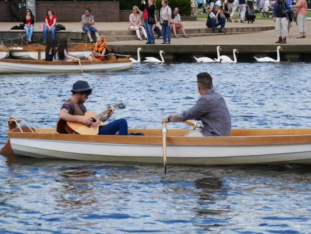 singing and rowing on the river