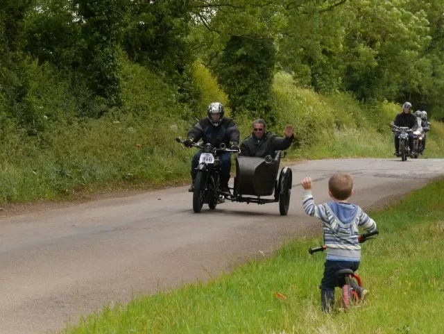 waving to the Banbury Run motorcycle rally