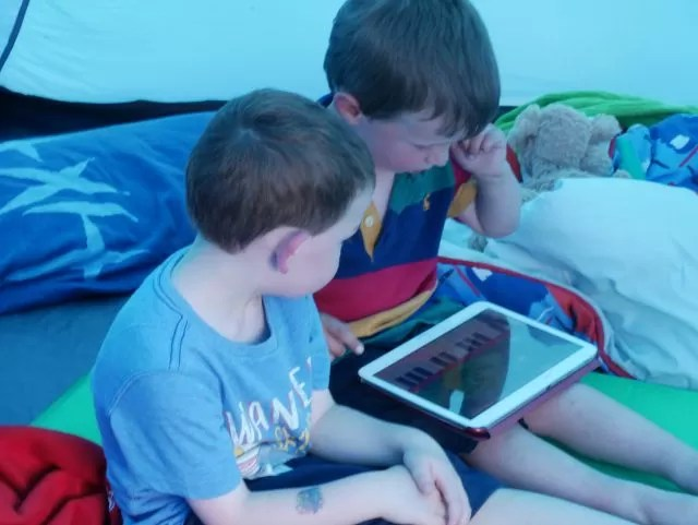 2 boys playing with a Samsung Tablet