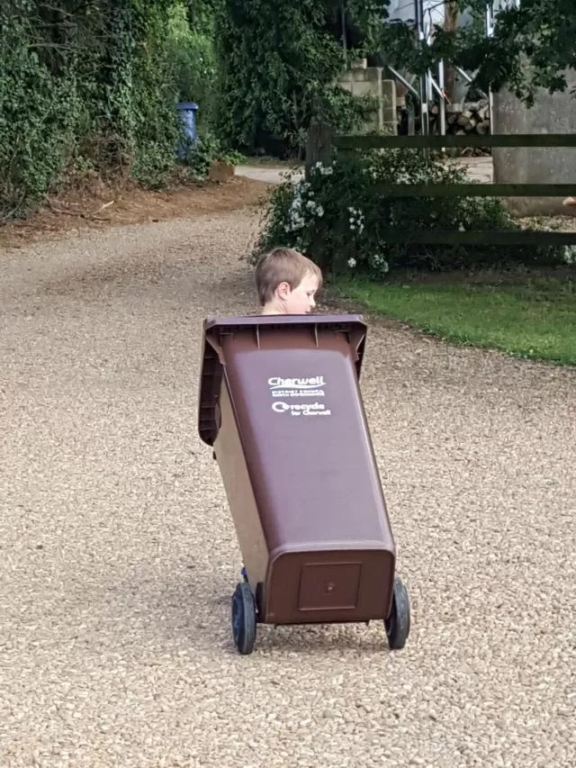helping out and taking the recycling wheely bin to the farm gate