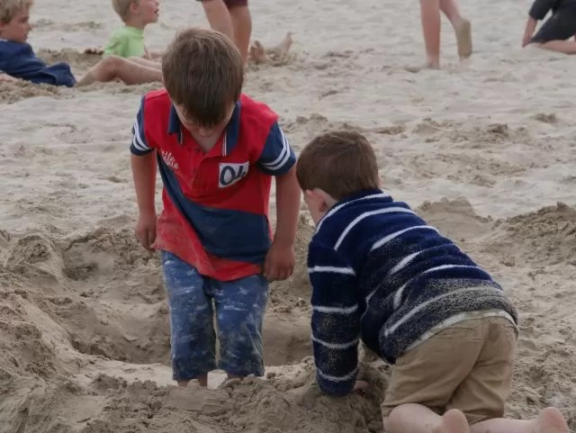 Playing with a friend in the sand