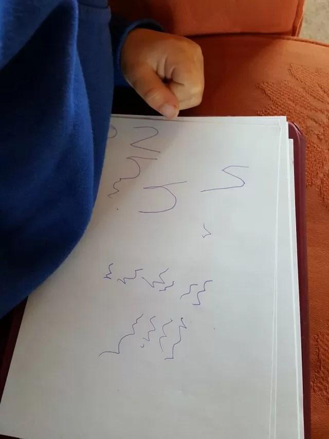 practising writing his name