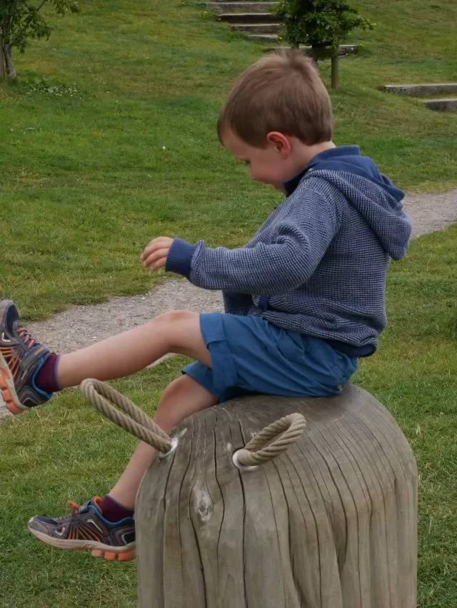 balancing on the wooden sheep