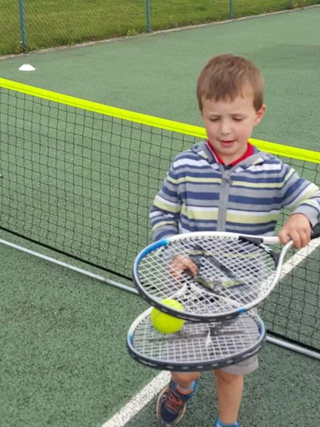 balancing tennis balls