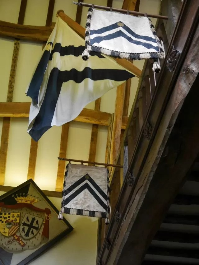 flags in the great hall at Packwood House
