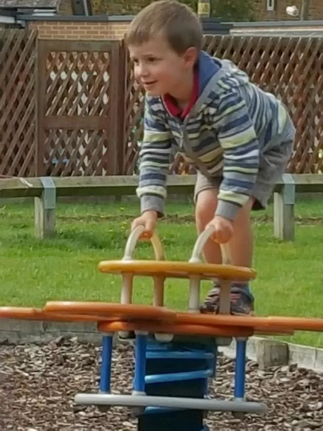 standing on the wobble equipment at the park
