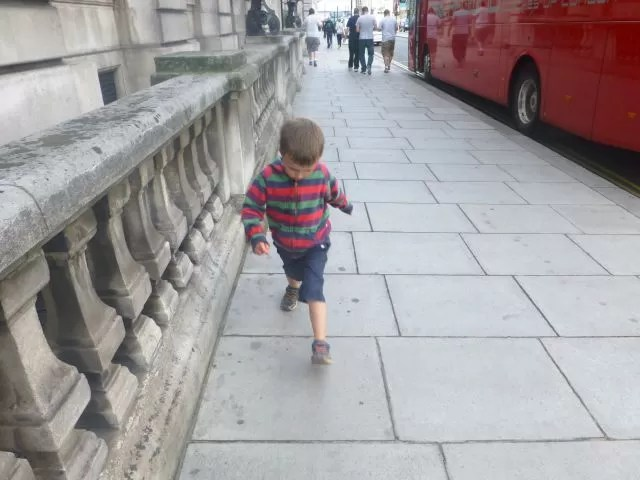 striding to avoid the cracks on the pavement