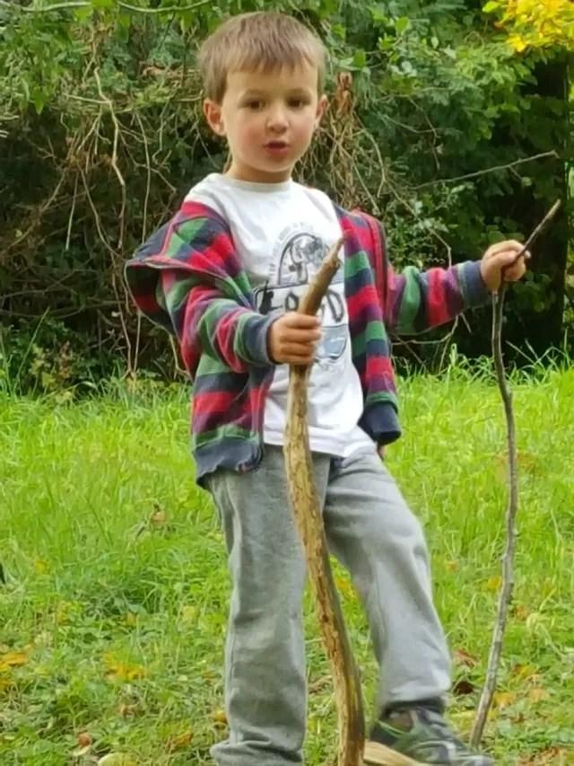 one boy and his sticks at Batsford Arboretum