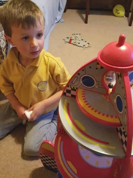 putting the pieces on the rocket toy