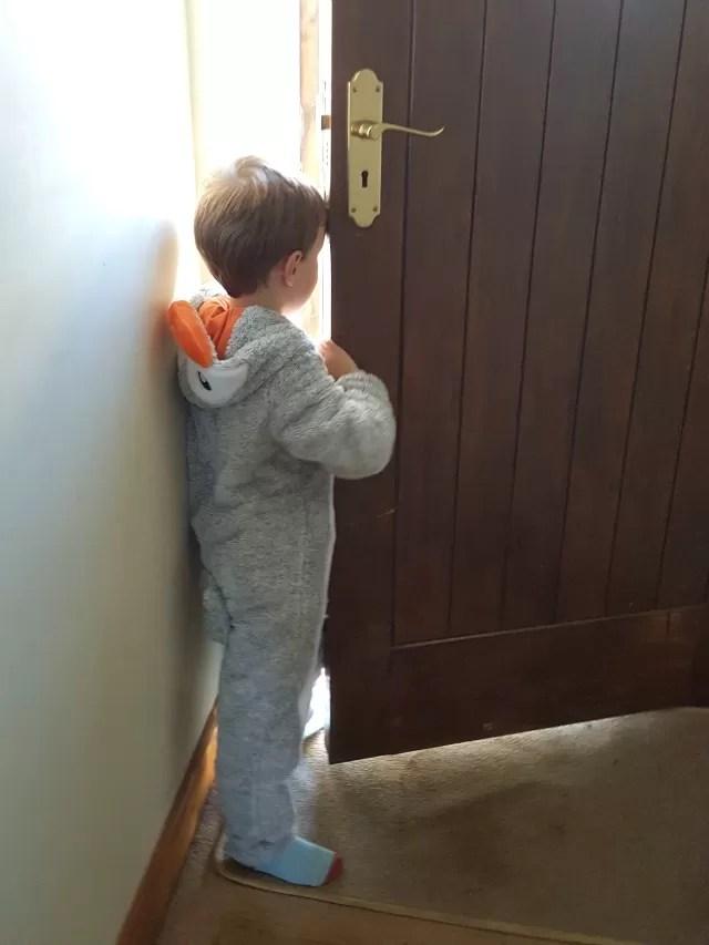 cute penguin onesie - looking out the door