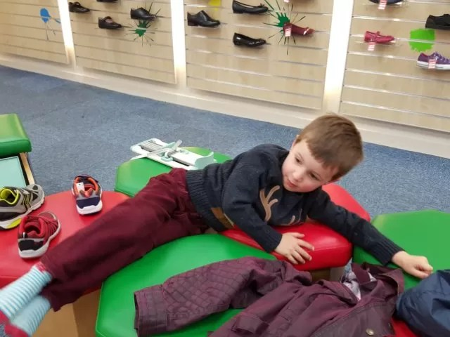 sprawling in the shoe shop