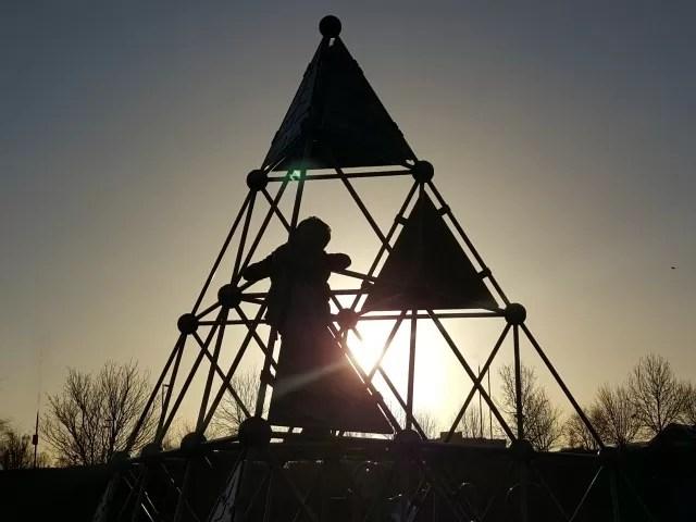 morning sunlight through a climbing frame silhouette