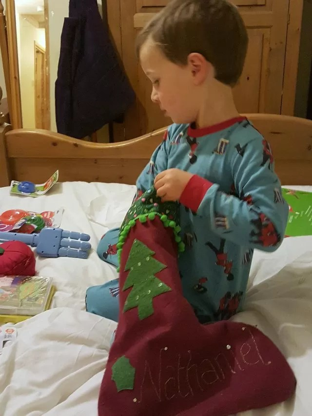 opening christmas stockings