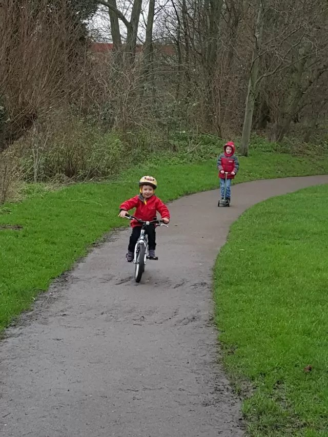cycling and scooting in the park
