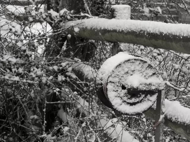 fence wire coil in the snow