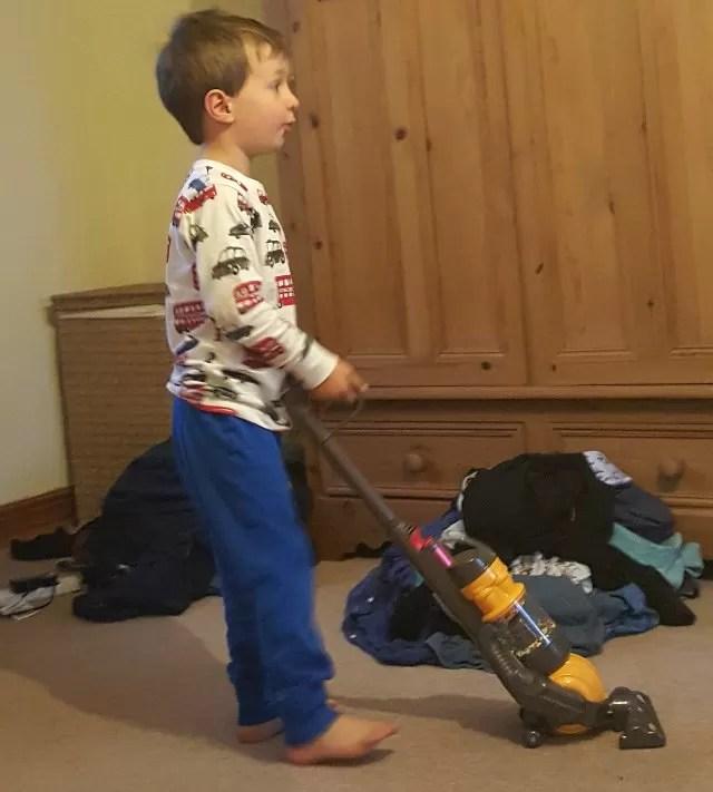 practising sorting washing and vacuuming