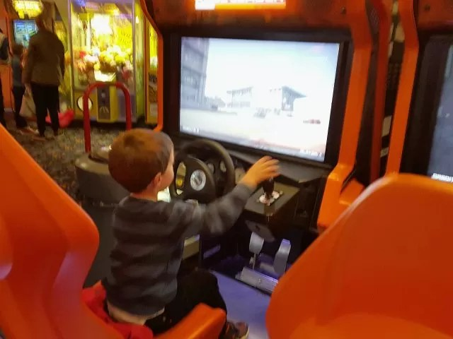 pretending to play race car games