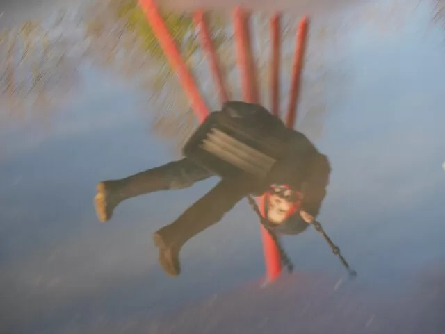 swinging reflection in puddles